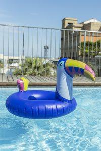 Needen BO2 - Aufblasbarer Schwimmring Lila Pelikan