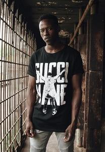 Merchcode MC104 - Gucci Mane Guwop Stance Tee